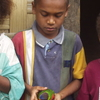 Ambae Children With Pet Lorikeet