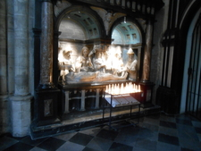 Statue And Candels At Cathedral