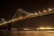 The Lighted Bridge As Seen From The Embarcadero