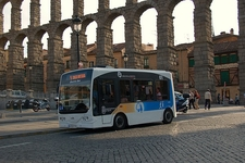 Tourists Beneath Segovia Aqueduct