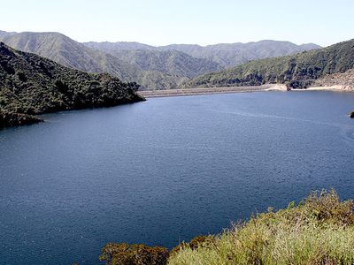 View Of The Nearly Full Reservoir With The Dam