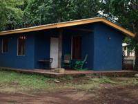 Little blue house with a garden