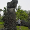 Man Standing Next To Largest Known Erected Latte Stone
