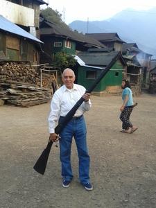 A Tourist Holding A Huge Gun