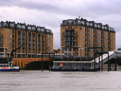 The Canary Wharf Ferry Approaching The Pier
