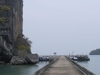 A Dock And 30m High Limestone Cliff