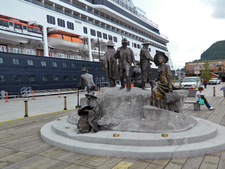 A Cruise Ship Is Seen Docked Next To Downtown Ketchikan And The Rock A Monument Honoring Ketchikans Pioneers