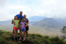A Group Of American Tourists Taking Photo In Front Of Bromo National Park