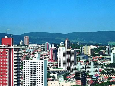 A View Of Downtown Jundia With Serra Do Japi In The Background
