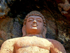 A Rock Cut Sitting Buddha Statue At Bojjannakonda