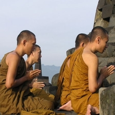 Buddhist Pilgrims Meditate On The Top Platform