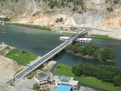 Swing Bridge Over Buna River
