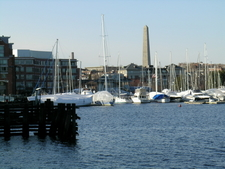 Sailboats Moored On The Charlestown,Charles River With Bunker Hill Monument