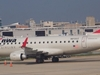 Northwest Airlines E-175 Parked At The Airport