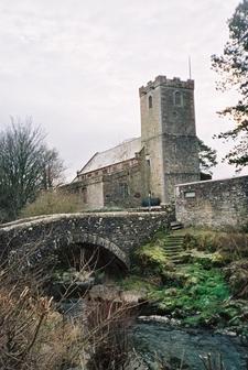 Caldbeck Bridge With The Church Beyond