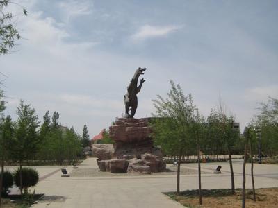 Dinosaur-Monument In The Local Park