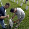 Crew Works To Straighten Grave Stones