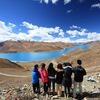 Group Of Hikers At Yamdrok Lake In Tibet - China