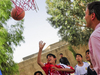 Kids Playing Basketball In  Farah