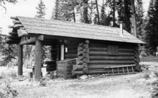Lower Logging Lake Snowshoe Cabin And Boathouse At Glacier - USA
