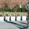 Lone Sailor Standing In Front Of Memorials