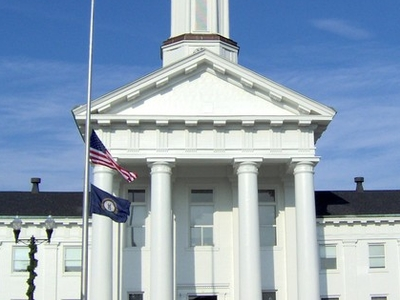Madison County Courthouse Richmond With Flags At Half Staff In