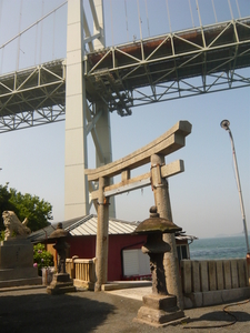A Torii Standing With Kanmonkyo Bridge
