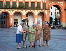 Old Women Gathering In Plaza Corredera Of Cordoba
