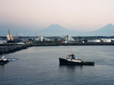 Puerto Quetzal Seen At Dawn With The Volcanoes On The Horizon