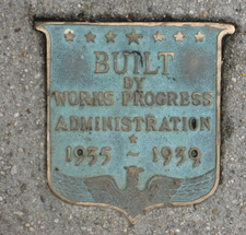 Plaque Embedded In The Sidewalk