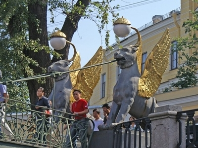 Gilded Wings Of Griffin Statues