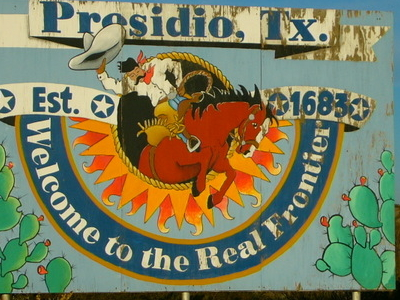 Signpost Outside The City Of Presidio Texas