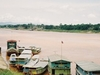Slow Boats Moored Outsided Ban Houayxay On The Mekong River. Chi