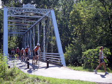 Summer Cyclists Along The Trail