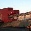 Two Loaders Work Outside The Plant