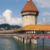 The Kapellbrücke In Lucerne With Its Wasserturm (water Tower)