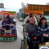 Tourists Enjoying Taxi Ride In Puno City - Peru
