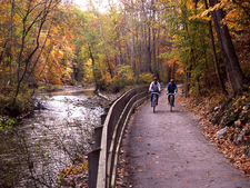 Towpath Bikers In The Fall