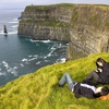 Travellers At Cliffs Of Moher In Ireland