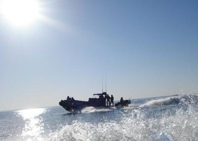 US Navy Boat Patrolling Lake Qadisiyah
