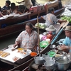 Vendors At Damnoen Saduak Floating Market