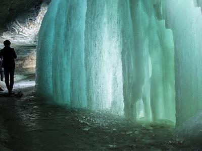 Walking Behind Frozen Falls