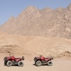 Sunset desert safari trip by quad runner
