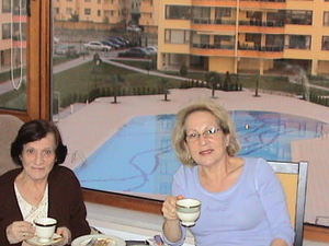 near city,pool, mother daughter