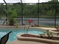 Your lake front, pool home awaits.