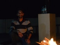 Bonfire At Roof Top With Friends