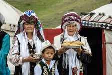 Kyrgyz Women And Child Offering Bread And Salt