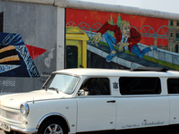 Trabi Stretch-limousine Infront Of The East Side Gallery In Berlin
