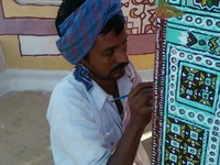 Artist Working On Pillar.